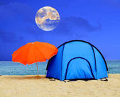 Full moon over camping tent