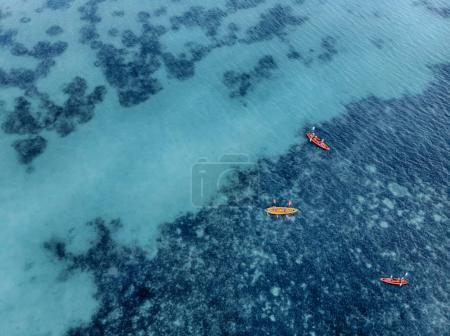 group of 3 Kayaks at calm water