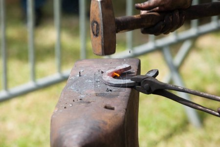 hammersmith makes horseshoe on anvil