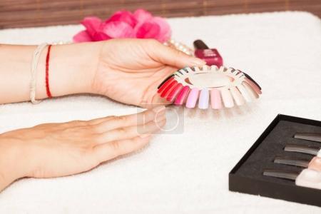 woman choosing nail polish