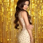 Gorgeous woman brunette in golden sparkling dress....