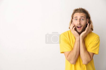 Photo for Portrait of surprised man on light background - Royalty Free Image