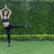 Asian sport woman doing exercise and stretching by...