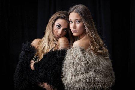 Two ladies in fur coats