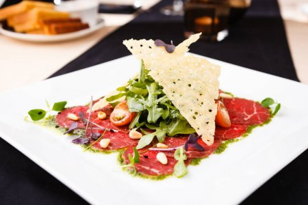 Beef carpaccio with salad