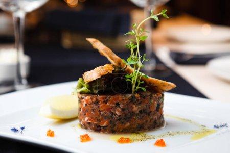 Salmon tartar with red caviar