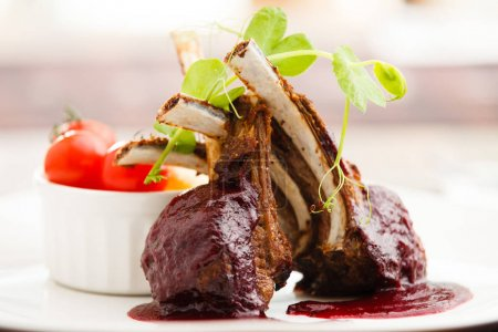 Grilled lamb with cranberry sauce