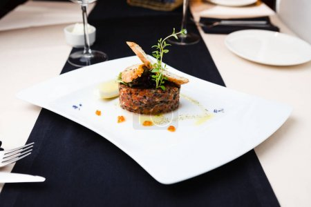 Photo for Salmon tartar with red caviar and ginger croutons - Royalty Free Image