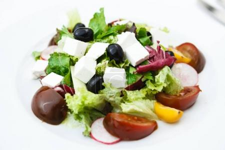 Photo for Salad with feta cheese, olives and cherry tomatoes - Royalty Free Image