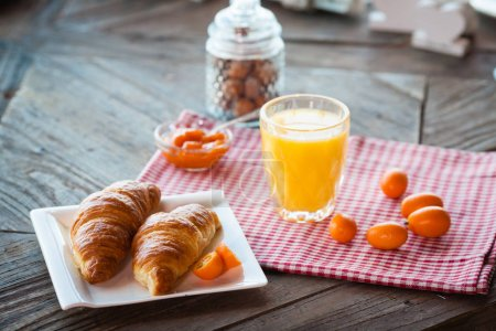 Photo for Healthy english breakfast with toasts, orange juice and jam on the table close up - Royalty Free Image
