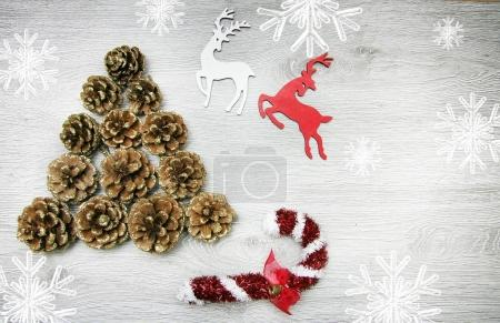 Christmas and New Years composition. The pine cones, spruce branches on a wooden white background