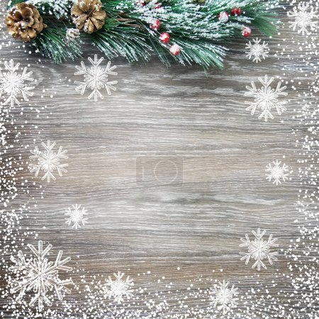 Christmas and New Years composition. The pine cones, spruce branches on a wooden background