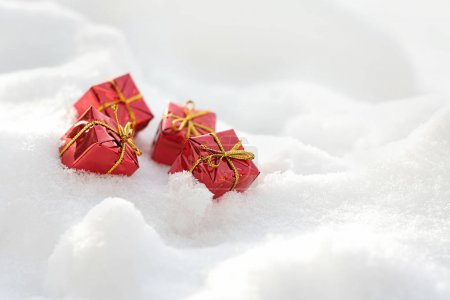 Red gift boxes on the snow