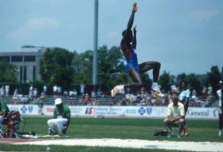 Carl Lewis in midair