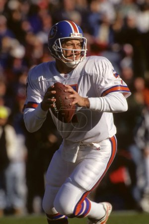 Quarterback John Elway of the Denver Broncos in game action.
