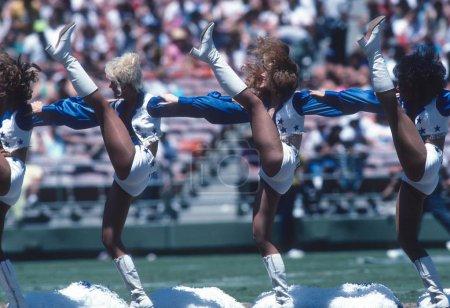 Dallas Cowboys Cheerleaders cheering at a Dallas home game.
