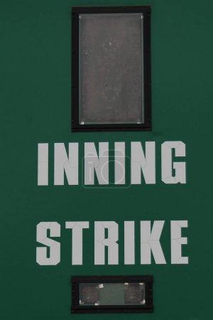 Baseball scoreboard at a Baseball game with descriptions of words on a scoreboard. The scoreboard was located in Queen Creek Arizona,
