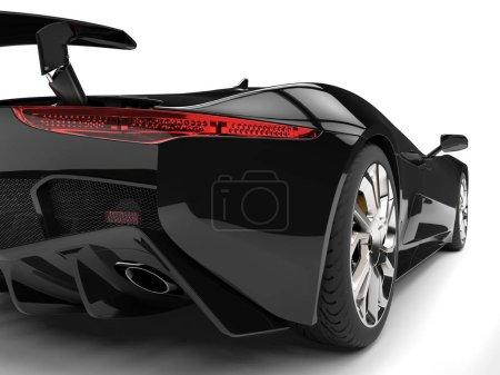 Photo pour Grand jet noir moderne élégante super voiture - feu arrière gros plan - image libre de droit