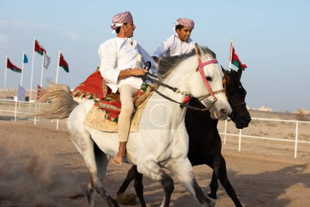 Omani men showing off their