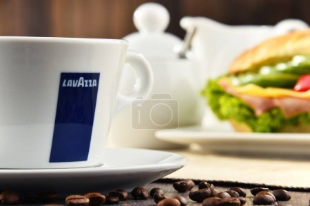 Composition with cup of Lavazza coffee and sandwich
