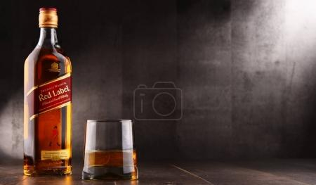 Glass of whisky and bottle of Johnnie Walker