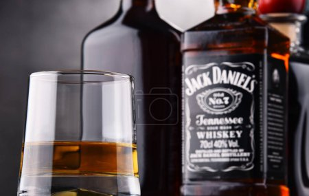 Glass of whiskey and bottle of Jack Daniel's
