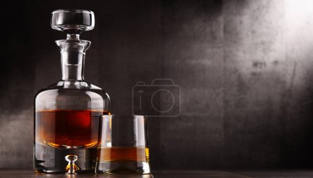 Composition with glass and carafe of hard liquor
