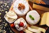 Different sorts of cheese on kitchen table