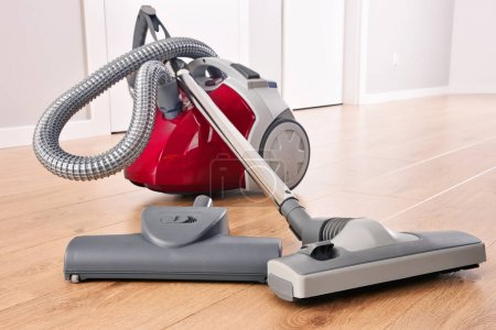 Canister vacuum cleaner for home use on the floor ...