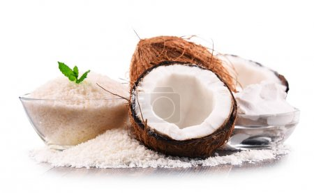 Composition with shredded coconut and shells isolated on white