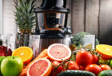 Photo for Slow juicer with organic fruits and vegetables. Detox diet - Royalty Free Image