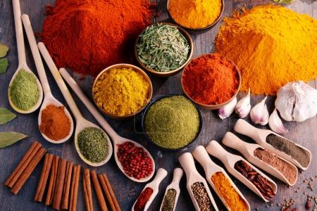 Photo for Variety of spices and herbs on kitchen table. - Royalty Free Image