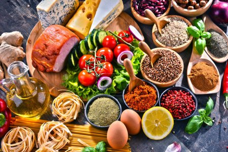 Photo for Composition with assorted organic food products on the table. - Royalty Free Image