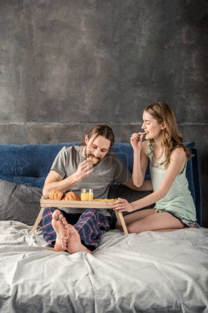 Couple has breakfast in bed