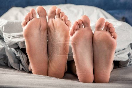 Feet of man and woman