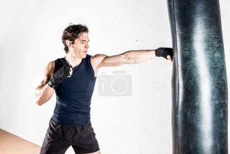 Muscular kickbox fighter