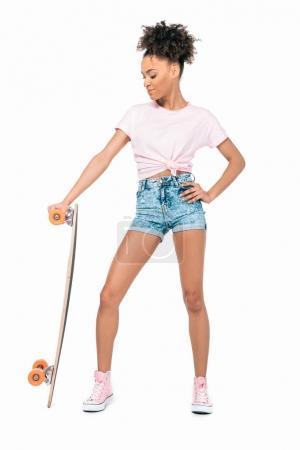 african american girl holding skateboard