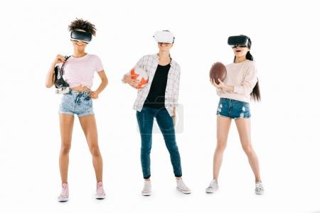 Multiethnic girls in virtual reality headsets