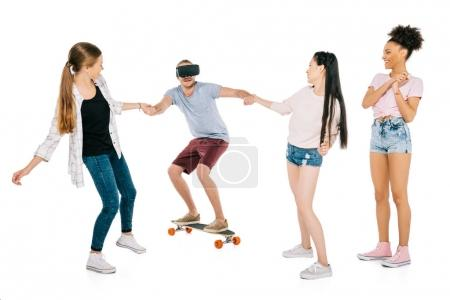 girls and young man on skateboard