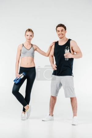 couple with fitness shakers