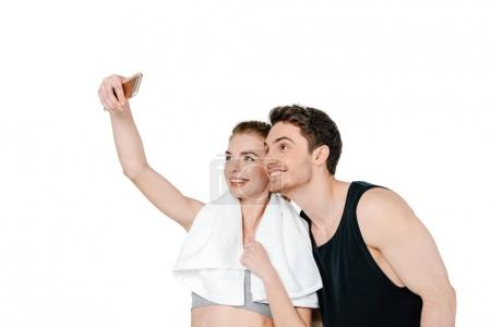 Happy fit couple taking selfie