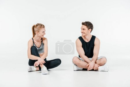 fit couple relaxing on floor