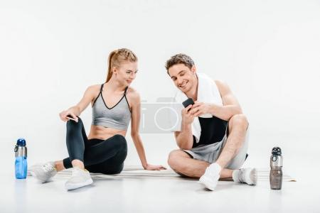Couple looking at phone after workout