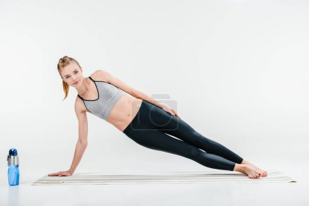 girl doing side plank exercise