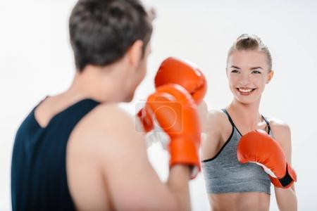 Young girl boxing with trainer