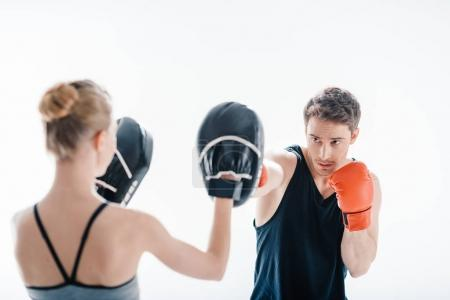 man boxing with female trainer