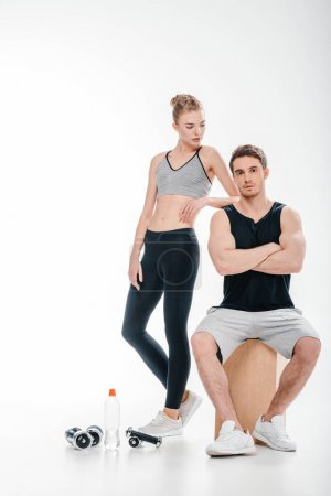 couple posing with fitness equipment