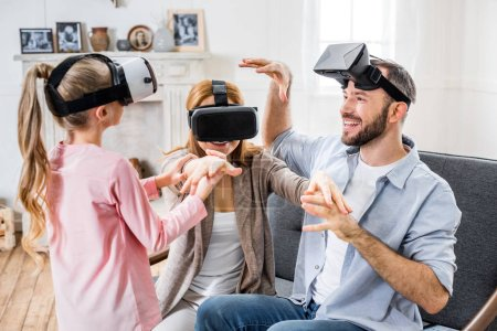 Photo for Happy family having fun together in virtual reality headsets - Royalty Free Image