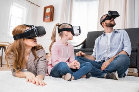 Photo for Family with one child using virtual reality headsets at home - Royalty Free Image