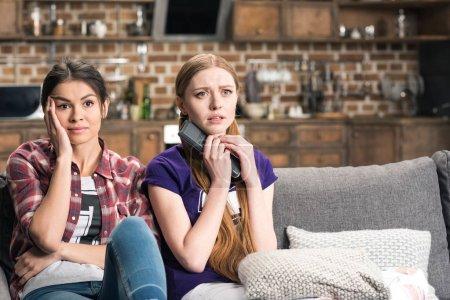 Young women watching tv